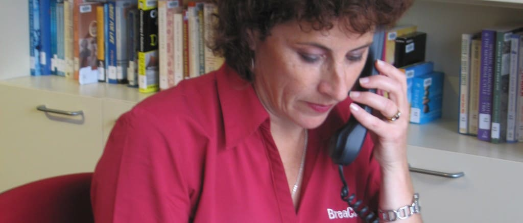 volunteer speaking the phone