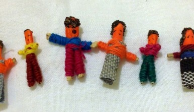Photo of a row of Guatemalan Worry Dolls