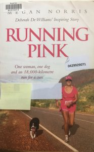 Cover of Pink Running, showing Deborah De Williams and her dog running along an Australian country road.
