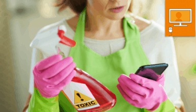 women holding spray bottle and looking at phone