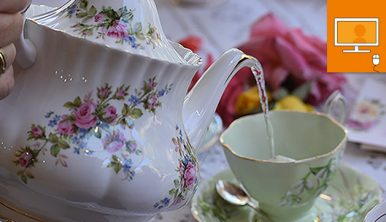 tea pot and cup on table