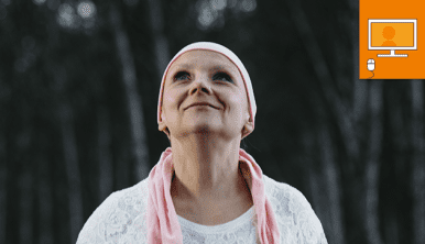 woman in headscarf looking up to sky and smiling