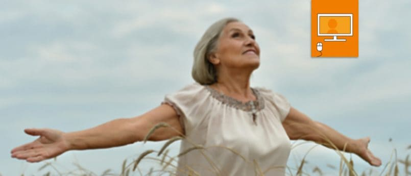 woman in field with outstretched arms